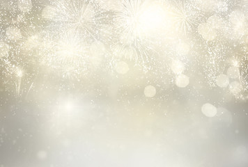 Abstract festive silver winter bokeh background with fireworks and bokeh lights