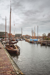 Moored ships in the harbor of the former fishing village Spakenburg in the Netherlands