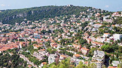 Impression of the city of Villefranche-sur-Mer with Fort du Mont Alban on top of the mountain