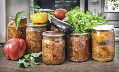 Home canning: canned vegetables in glass jars.