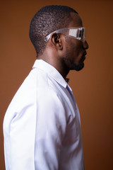 Handsome African man doctor wearing protective glasses
