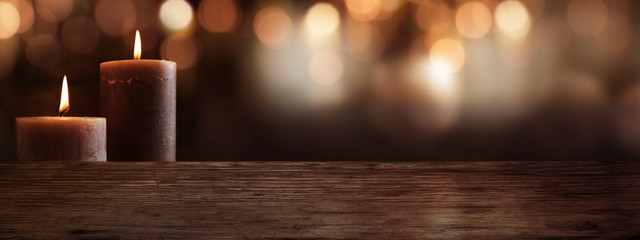 Candles with wooden table and bokeh background