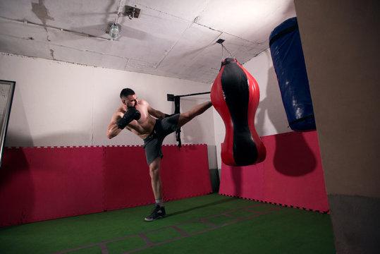 Young man kickboxing workout