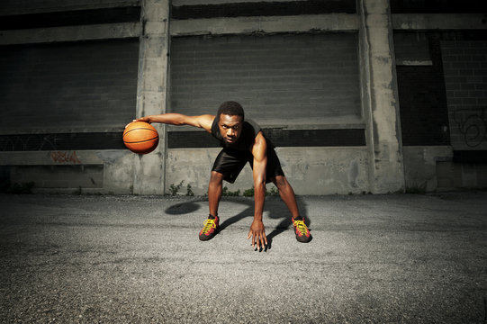Portrait of confident basketball player on street