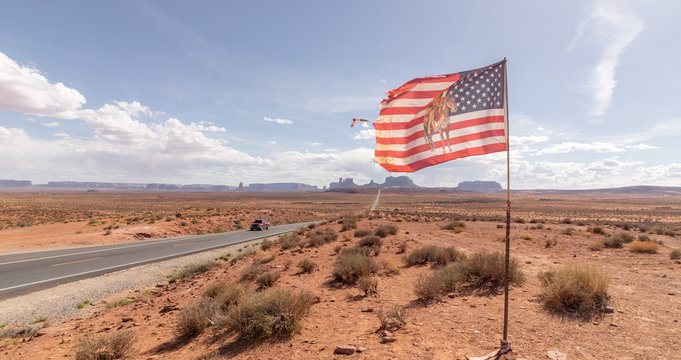 image of a truck and the American Flag in the famous road to Monument Valley