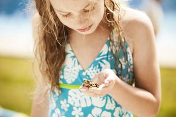 Girl holding frog