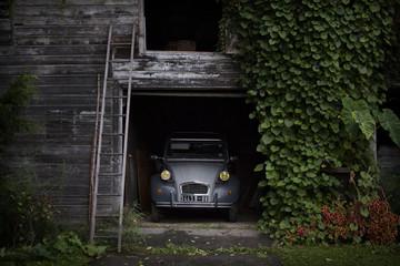 Vintage car in wooden house garage
