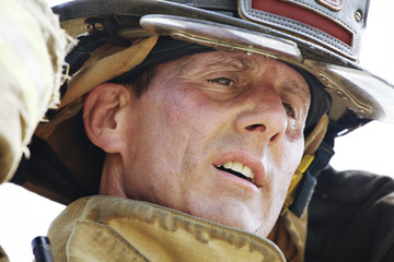 Close-up of exhausted firefighter