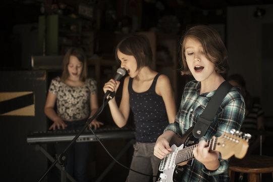 Girls singing in recording studio
