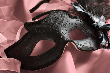 carnival venetian mask on a pink background