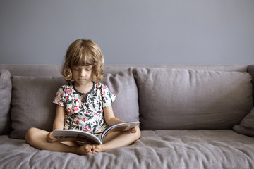 Girl studying while sitting on sofa at home