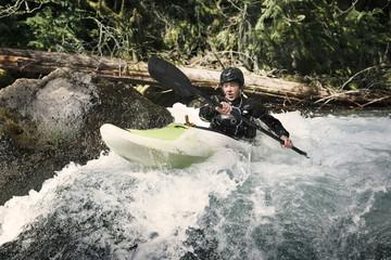 Happy man kayaking in river