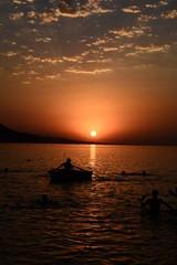 Beautiful blazing sunset landscape at Caspian Sea and orange sky above.