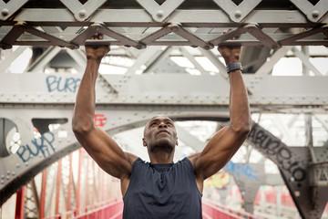 Man hanging at bridge