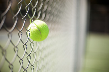 Tennis ball stuck in chainlink fence