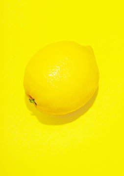 Lemon against yellow background