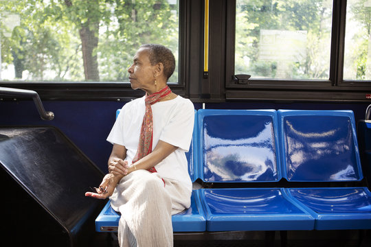 Woman looking away while traveling in bus
