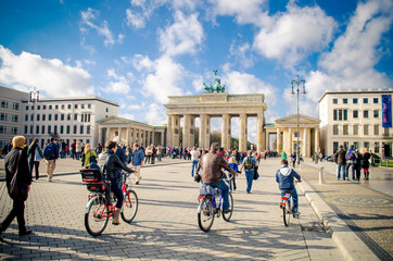 People cycling near Brandenburg Gate, Berlin, Germany
