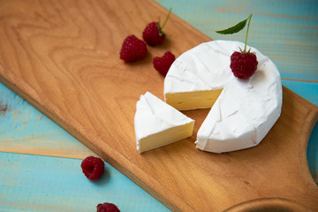cheese camembert with raspberries and grapes table