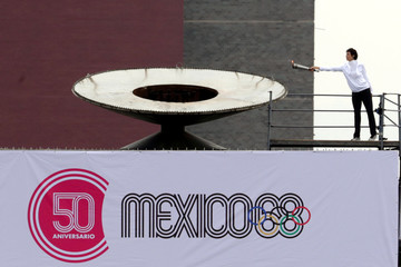 Enriqueta Basilio holds the Olympic torch before lighting the cauldron at the University Olympic Stadium to mark the 50th Anniversary of the 1968 Olympic Games, in Mexico City
