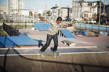 Man performing stunt while skateboarding on sports ramp