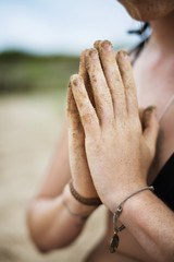 Close up of woman with hands clasped in prayer position
