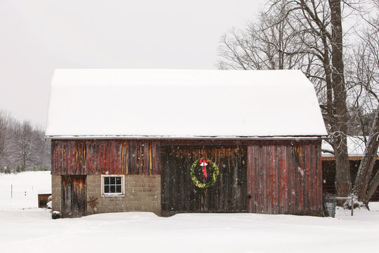 Wreath on snow covered barn during Christmas
