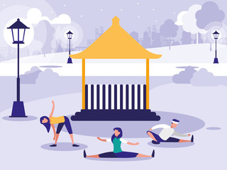 people performing stretching in park with kiosk
