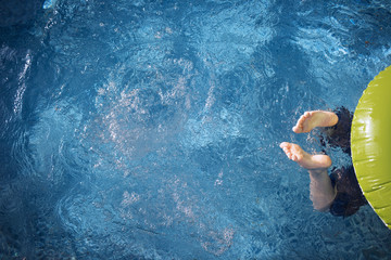 Cropped image of boy swimming in pool