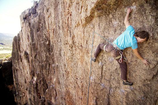 Man climbing mountain, Colorado, USA