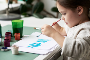 Amputee child painting