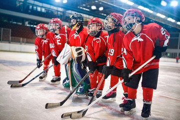 young hockey team - children play hockey.