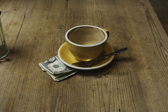 Empty coffee cup with payment