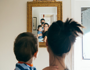 Family taking a picture in a mirror