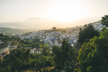 Panorama of Chefchaouen, Morocco at golden hour before sunset. Town famous by the blue painted walls of the houses