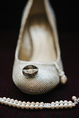 High Heels, Earrings, rings, pearl bracelet