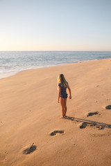 Young girl standing in sand on the beach