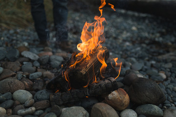 campfire fire on rocky beach