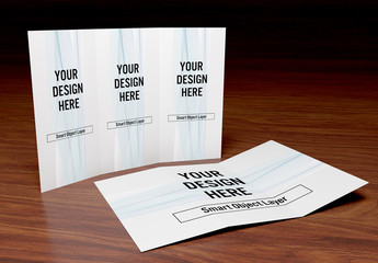 2 Trifold Brochures on Wooden Table Mockup