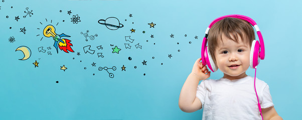 Idea rocket with toddler boy with headphones on a blue background