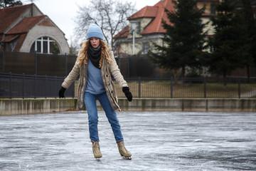 Young woman riding skates