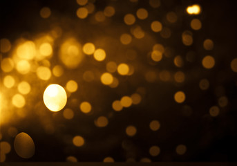 holiday abstract glitter background with blinking stars and falling snowflakes. Blurred bokeh of...
