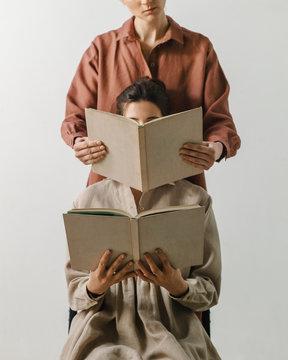 Unrecognizable women with books