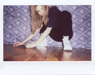 Casual model in posture on floor