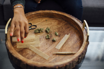Woman Rolls a Joint