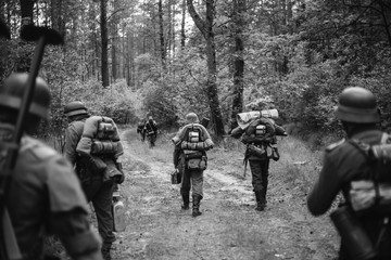 Re-enactors Dressed As German Infantry Soldiers In World War II