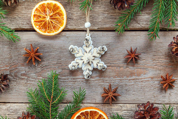 Christmas New Year composition with tree toy fir branch pine cones orange slices on old shabby rustic wooden background Xmas holiday december decoration. Flat lay top view Time for celebration concept