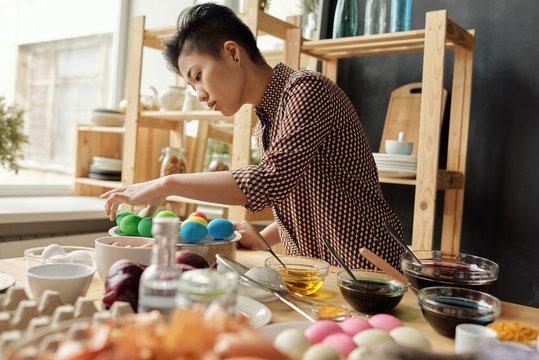 Woman preparing for Easter celebration