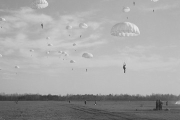 Military paratroopers in the sky