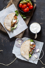 Pita bread filled with vegetables and chicken gyros